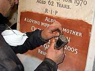 Hand Cutting the Inscription to Match the Existing